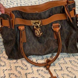 Well loved Michael Kors purse